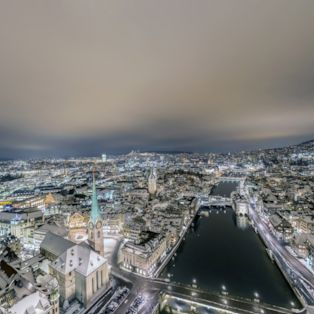 Take in an aerial view of Zurich, Switzerland, glittering on a winter's night