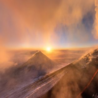 Russian volcano Klyuchevskaya Sopka looks spectacular erupting in the setting sunlight