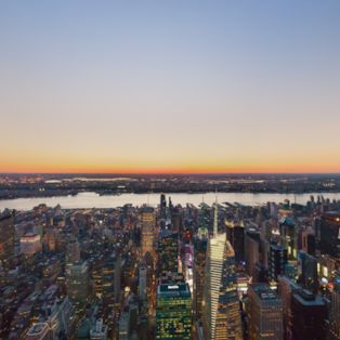 From high above central Manhattan, see the sights of New York City at sunset