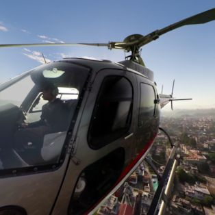 Strap in for a spectacular flight over Kathmandu and the majestic Budhanilkantha Temple