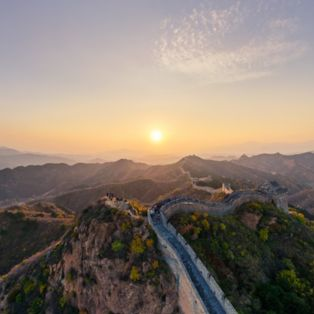 Enjoy a gorgeous sunset over the Great Wall of China, truly a Wonder of the World