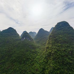 Fly over a valley in China's unique and distinctive Guilin Mountains