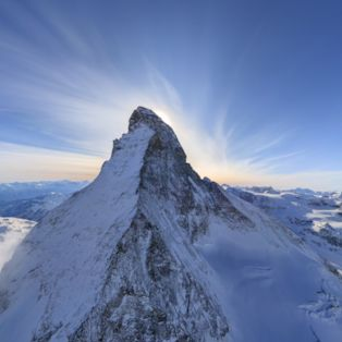 Survey the pyramidal peak of the Matterhorn mountain from its north-east slope